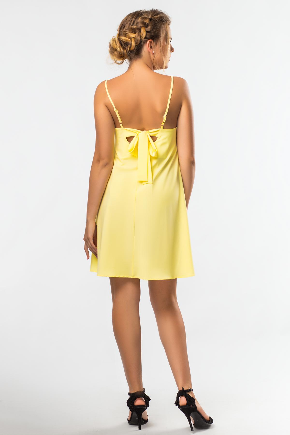 Платье с бантиками на спине